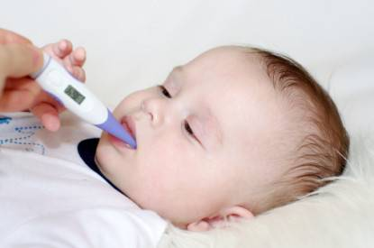 baby and electronic thermometer